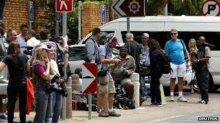 Members of the media wait for Oscar Pistorius outside the Brooklyn police station in Pretoria (25 February 2013)