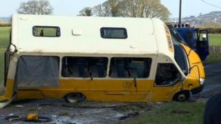 School bus in the process of being righted