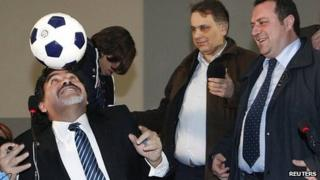 Diego Maradona balances a ball on his head during news conference in Naples. 26 Feb 2013