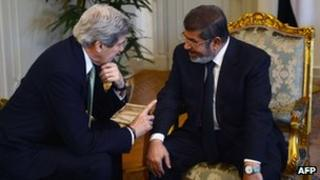 US Secretary of State John Kerry and Egyptian President Mohammed Morsi in Cairo. Photo: 3 March 2013