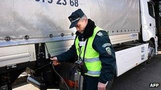 Bulgarian policeman checking lorry on border, file pic
