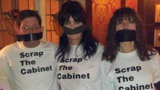 Mark Sharp, Patsy Link and Sheena Walker wearing 'Scrap the Cabinet' T-shirts