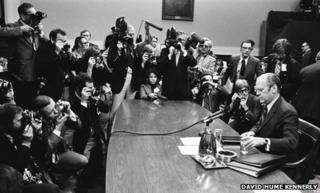 Surrounded by members of the press, President Gerald Ford answers questions about the pardon of Richard Nixon, 17 October 1974. (David Hume Kennerly Photographic Archive Dolph Briscoe Center for American History The University of Texas at Austin)