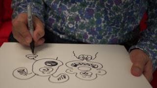 Nick Park drawing Wallace and Gromit