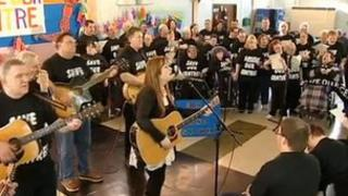 Campaigners singing 'Stand Together'