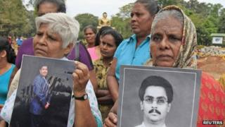 Sri Lankan Tamil women hold up photographs of their missing sons during a protest against the Sri Lankan government in Colombo on Wednesday (6 March 2013)