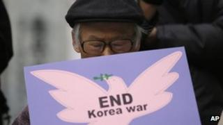 A South Korean protester in Seoul seeks an end to hostilities with Pyongyang