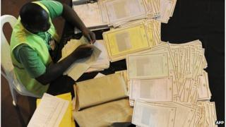 An Independent Electoral and Boundaries Commission (IEBC) officer goes through certificates and tallying forms on March 7,2013 in Nairobi