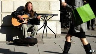 Jobless man busking