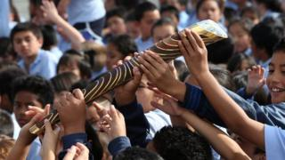 Pupils of Chapel Downs Primary School, Auckland, New Zealand, pass the baton around as part of the Delhi 2010 rela
