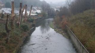 Stretch of the Rhondda Fawr discoloured by sewage