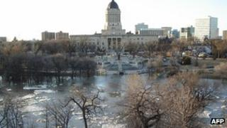 The Assiniboine River in Winnipeg overflows its banks 7 April 2006