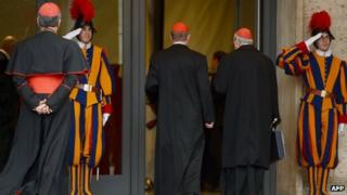 Swiss guard salutes as Cardinals arrive at the Vatican. Photo: 8 March 2013