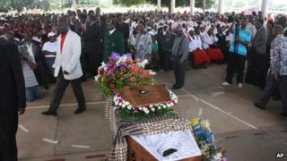 The funeral for Mozambican taxi driver Mido Macia gets under way in Matola