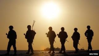 South Korean marines patrol on Yeonpyeong Island near the western maritime border between the two Koreas, 10 March 2013
