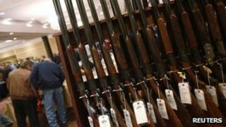 A row of shotguns are seen during the East Coast Fine Arms Show in Stamford, Connecticut, 5 January 2013