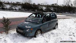 A car left abandoned at Pease Pottage following a crash