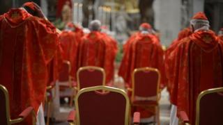 Cardinals praying during the papal election