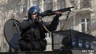 A policeman facing down protesters in Azerbaijan