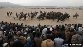 Afghans watch a game of buzkashi in Herat, January 2013