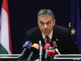 Prime Minister Viktor Orban of Hungary listens to reporters' questions in Brussels, 14 March