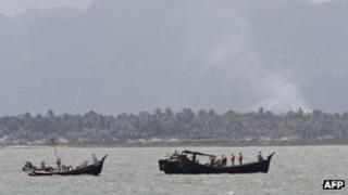 Boats transporting Rohingya Muslims fleeing sectarian violence June 11, 2012