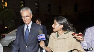 Mr Mancini leaving India's Ministry of External Affairs on 12 March