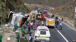 A photo taken on March 15, 2013 shows the wreckage of a double-decker bus carrying a church group that crashed in a mountainous pass near Cape Town, killing twenty-four people.