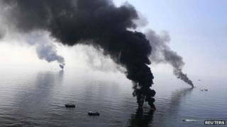 Smoke rises from a controlled burn of the Deepwater Horizon oil spill in 2010