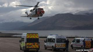Coastguard helicopter and mountain rescue team vehicles