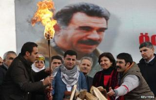 People celebrate the Kurdish New Year in Istanbul in front of an image of PKK leader Abdullah Ocalan, 17 March