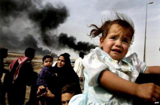 2003 file photo shows Iraqi families leaving Basra in southern Iraq