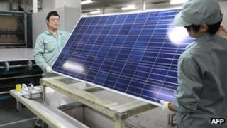 Workers in a Suntech factory in China