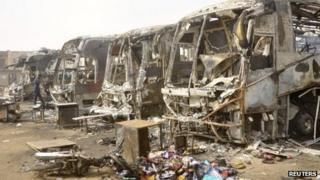 The charred remains of buses after Monday's attack at a bus park in Sabon Gari in Kano