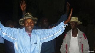 Fugitive Congolese warlord Bosco Ntaganda (L) dances alongside his commanders in Tebero, Masisi, on 18 November 2005