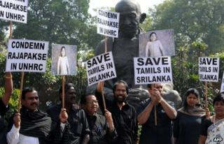 "In this photograph taken on March 5, 2013 Dravida Munnetra Kazhagam (DMK) Members of India""s Parliament shout slogans and wave placards during a protest outside Parliament in New Delhi against Sri Lanka""s President Mahinda Rajapaksa as they condemn the killing of Tamils in Sri Lanka."