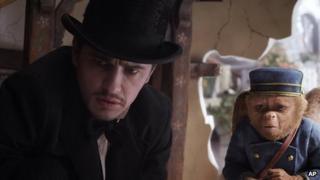 James Franco and friend in Oz the Great and Powerful