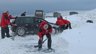 Kirkby Stephen Mountain Rescue Team digging out trapped vehicles