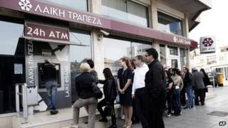 Queue at a cash machine outside a closed Laiki Bank branch in Nicosia
