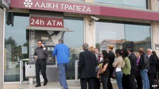 Bank customers at ATM in Nicosia, 21 Mar 13