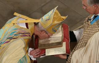 Justin Welby kissing the Canterbury Gospels