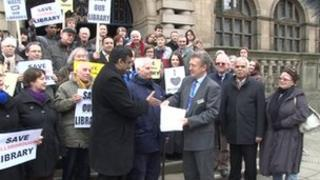 Protesters hand over petition