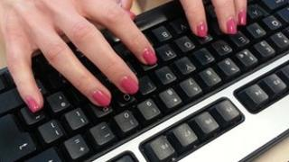 Hands at keyboard