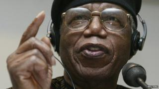 Nigerian author Chinua Achebe gestures during a news conference held during the Frankfurt bookfair on 12 October 2002