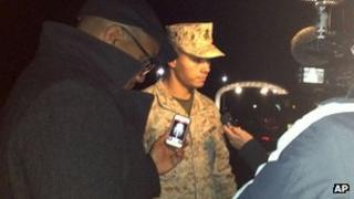Marine Base Quantico spokesman Lt Agustin Solivan briefs reporters on the base on 22 March 2013