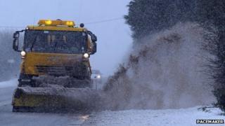 Gritter drives through slush puddle