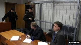 Court scene with empty cage, 22 Mar 13