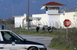 Police search ground outside the prison near Trikala, Greece, 23 March