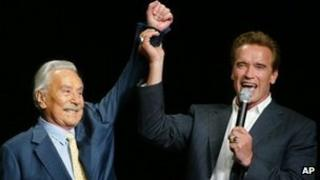 Arnold Schwarzenegger, right, raising the arm of Joe Weider, the creator of Mr Olympia Bodybuilding competition, during the 39th annual Mr Olympia event in Las Vegas, file pic from 2003