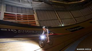 Cyclist in Sir Chris Hoy Velodrome during Earth Hour
